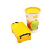 Caixa de almoço escolar & vidro do suco no fundo branco Fotos de Stock Royalty Free