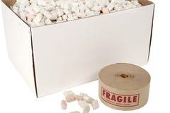 Caixa de amendoins da embalagem com rolo da fita frágil Imagem de Stock Royalty Free