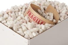 Caixa de amendoins da embalagem com rolo da fita frágil Foto de Stock Royalty Free