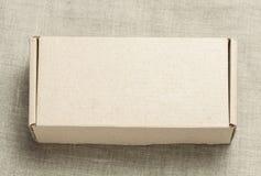 Caixa de cartão em um fundo de madeira Imagem de Stock Royalty Free
