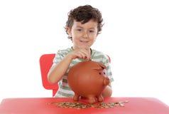 Caixa de dinheiro do whit do menino foto de stock royalty free