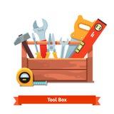 Caixa de ferramentas de madeira completamente do equipamento Fotos de Stock Royalty Free