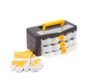 Caixa de ferramentas plástica e luvas de couro Foto de Stock Royalty Free