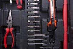Caixa de ferramentas preta com instrumentos da diferença Imagem de Stock Royalty Free