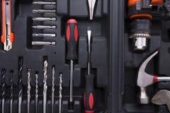 Caixa de ferramentas preta com instrumentos da diferença Fotos de Stock Royalty Free