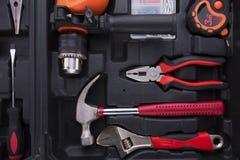 Caixa de ferramentas preta com instrumentos da diferença Foto de Stock Royalty Free