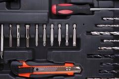 Caixa de ferramentas preta com instrumentos da diferença Fotografia de Stock