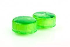 Caixa de lente verde do contato foto de stock royalty free