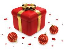 Caixa de presente com as esferas listradas vermelhas do Natal Fotos de Stock Royalty Free