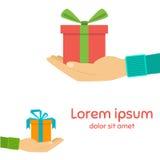Caixa de presente dos ícones na palma, um presente à disposição Foto de Stock