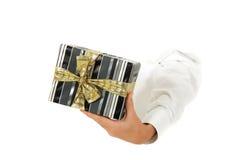 Caixa de presente, mão. Foto de Stock