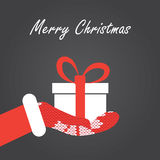 Caixa de presente na mão de Santa Imagem de Stock