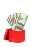 Caixa de presente vermelha com o dinheiro isolado no branco fotografia de stock royalty free