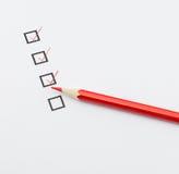 Caixa de seleção e lápis vermelho Imagem de Stock Royalty Free