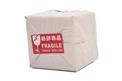 Caixa do pacote postal ou caixa de transporte com a Fotos de Stock