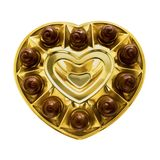 Caixa dos chocolates na forma de um coração Fundo branco isolado fotografia de stock royalty free