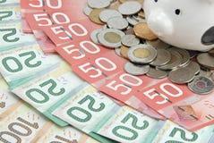 Caixa e dinheiro da economia Fotografia de Stock