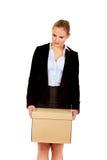 Caixa levando triste da mulher de negócio após ter afrouxado o trabalho fotografia de stock