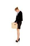 Caixa levando triste da mulher de negócio após ter afrouxado o trabalho fotos de stock