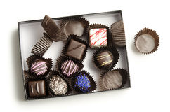 Caixa Metade-Comida dos chocolates Fotos de Stock