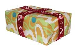 Caixa multi-colorida isolada com fita vermelha Fotografia de Stock Royalty Free