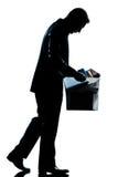 Caixa pesada carreg despedida homem da silhueta Imagens de Stock Royalty Free