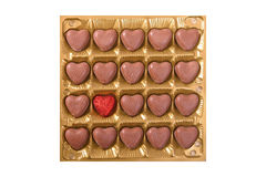 Caixa quadrada com bombons do chocolate da forma do coração Fotografia de Stock Royalty Free