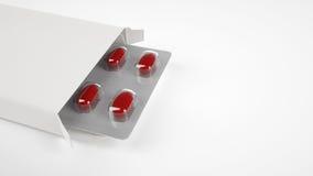 Caixa vazia do comprimido no fundo branco Fotografia de Stock