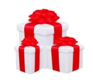 Caixas de presente com a curva vermelha isolada Fotografia de Stock Royalty Free