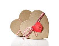 Caixas de presente dadas forma coração com etiquetas do coração Fotografia de Stock Royalty Free