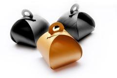Caixas de presente douradas no conceito de Dia das Bruxas Imagens de Stock Royalty Free