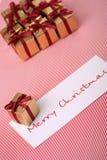 Caixas do ano novo com um cartão congratulatório Imagens de Stock