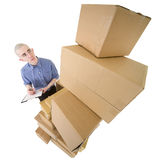Caixas do homem e de cartão da pilha Imagens de Stock