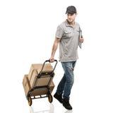Caixas e pacotes do caminhão de mão do correio Imagem de Stock Royalty Free