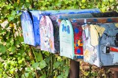 Caixas postais coloridas do vintage imagens de stock