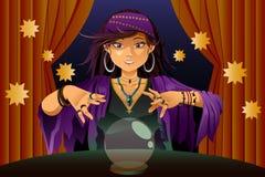 Caixeiro de fortuna que lê Crystal Ball Foto de Stock Royalty Free