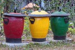Caixotes de lixo em três cores para o vário lixo Foto de Stock