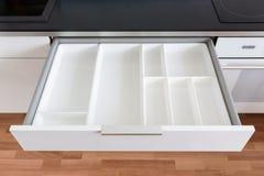Cajón abierto de la cocina fotografía de archivo