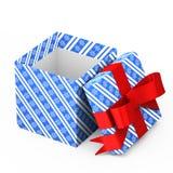 Caja azul con un arco rojo en el fondo blanco Imagen de archivo