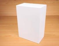 Caja blanca en blanco en el fondo de madera Fotos de archivo libres de regalías