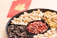 Caja china del bocado por Año Nuevo de China con el medio rojo l de la palabra del bolsillo Foto de archivo