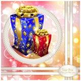 Caja coloreada de la Navidad con los regalos Imagen de archivo libre de regalías