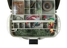 Caja con los aparejos de pesca en el fondo blanco fotografía de archivo libre de regalías