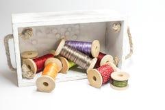 Caja con los carretes de la cinta Foto de archivo libre de regalías
