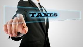 Caja conmovedora de los impuestos de la mano en la pantalla táctil Fotografía de archivo libre de regalías