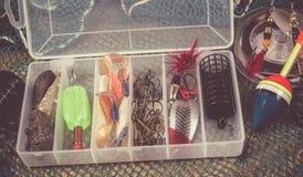 Caja de almacenamiento con los accesorios para pescar Imagen de archivo libre de regalías