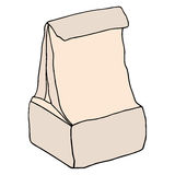 Caja de almuerzo escolar Bolso de la comida del papel de Brown aislado en blanco Mano d Fotos de archivo libres de regalías
