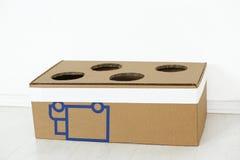 Caja de cartón con los agujeros Foto de archivo libre de regalías