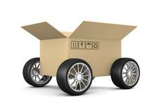 Caja de cartón en las ruedas Foto de archivo libre de regalías