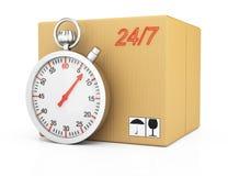 Caja de cartón y cronómetro Fotografía de archivo libre de regalías